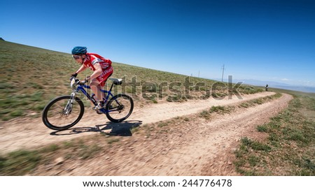 "ALMATY, KAZAKHSTAN - MAY 05, 2013: E.Kazantcev (N7) in action at Adventure mountain bike cross-country competition in mountains ""Jeyran Trophy 2013""  - stock photo"