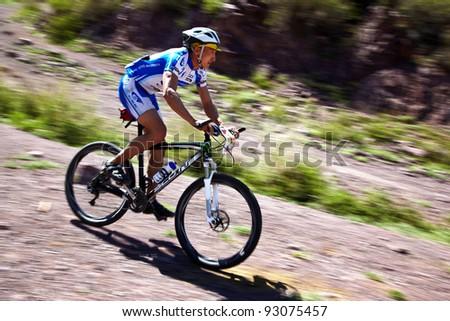 "ALMATY, KAZAKHSTAN - MAY 2: J.Satkynaliev (N1) in action at Adventure mountain bike cross-country marathon in mountains ""Jeyran Trophy 2011"" on May 2, 2011 in Almaty, Kazakhstan. - stock photo"
