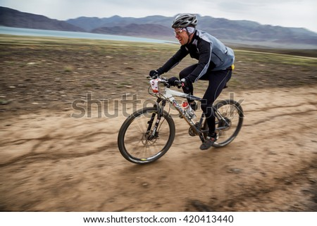 "ALMATY, KAZAKHSTAN - MAY 02, 2016: M.Kosyr (N5) in action at Adventure mountain bike cross-country competition in mountains ""Jeyran Trophy 2016""  - stock photo"