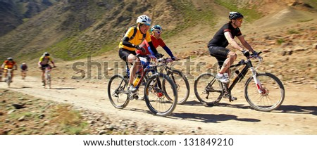 "ALMATY, KAZAKHSTAN - MAY 2: N.Eleusizov (N12) and other in action at Adventure mountain bike cross-country marathon in mountains ""Jeyran Trophy 2011"" on May 2, 2011 in Almaty, Kazakhstan. - stock photo"