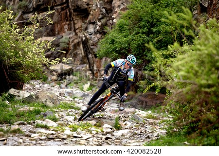 "ALMATY, KAZAKHSTAN - MAY 01, 2016: Unknown rider in action at Adventure mountain bike cross-country competition in mountains ""Jeyran Trophy 2016"""