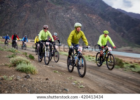 "ALMATY, KAZAKHSTAN - MAY 02, 2016: V.Malahovsky (N33) in action at Adventure mountain bike cross-country competition in mountains ""Jeyran Trophy 2016""  - stock photo"