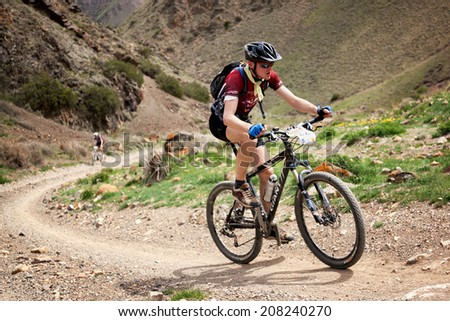 "ALMATY, KAZAKHSTAN - MAY 1: V.Philipchuk (N22) in action at Adventure mountain bike cross-country marathon in desert ""Jeyran Trophy 09"" on May 3, 2009 in Almaty, Kazakhstan. - stock photo"