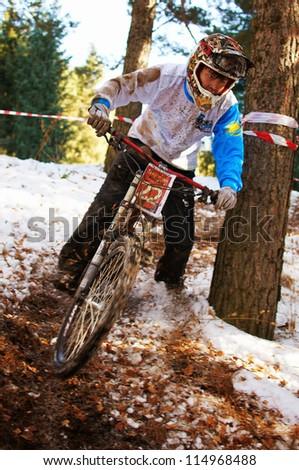 ALMATY, KAZAKHSTAN - NOVEMBER 06: D.Haybullin(N22) in action at downhill mountain bike 'Pumpkin Race Mini DH. Halloween' November 06, 2011 in Almaty , Kazakhstan. - stock photo
