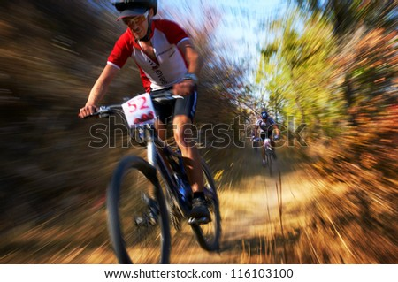 ALMATY, KAZAKHSTAN - OCTOBER 14: P.Krasovetsky (N52) in action at cross-country mountain bike 'Apple race' October 14, 2012 in Almaty, Kazakhstan. - stock photo