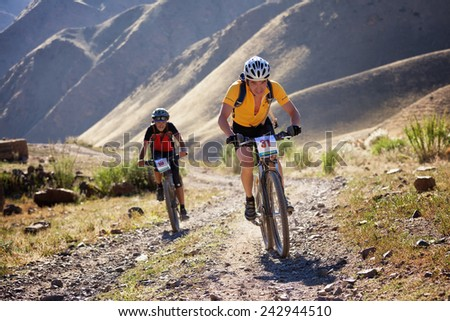 "ALMATY, KAZAKHSTAN - SEP 05, 2010: N.Eleusizov (N31) in action at Adventure mountain bike cross-country competition in mountains ""Bartogay Marathon 2010""  - stock photo"