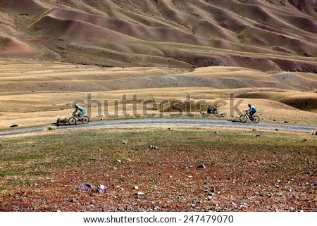 "ALMATY, KAZAKHSTAN - SEP 13, 2009: Unknown bikers in action at Adventure mountain bike cross-country competition in mountains ""Bartogay marathon 2009""  - stock photo"