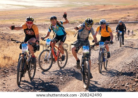 "ALMATY, KAZAKHSTAN - SEPTEMBER 09: A.Davydenko (N29) and other in action at Adventure mountain bike competition ""Marathon Bartogay-Assy-Batan 2012"" on September 09, 2012 in Almaty, Kazakhstan. - stock photo"