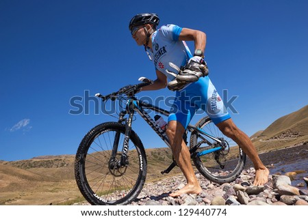 "ALMATY, KAZAKHSTAN - SEPTEMBER 09: An unidentified rider in action at Adventure mountain bike cross-country marathon ""Marathon Bartogay-Assy-Batan 2012"" on September 09, 2012 in Almaty, Kazakhstan."