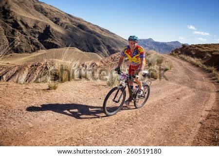 "ALMATY, KAZAKHSTAN - SEPTEMBER 09, 2014: E.Kazantcev (N39) in action at Adventure mountain bike cross-country marathon ""Marathon Bartogay-Assy-Batan"".   - stock photo"