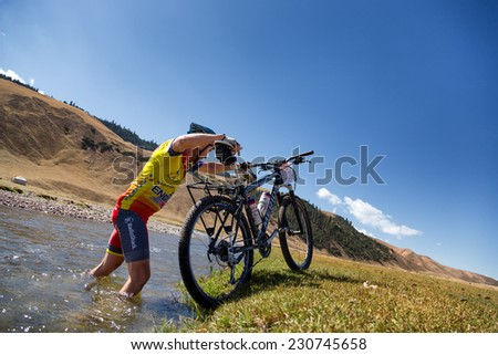 "ALMATY, KAZAKHSTAN - SEPTEMBER 09, 2014: E.Kazantchev (N39) in action at Adventure mountain bike cross-country marathon ""Marathon Bartogay-Assy-Batan ""  - stock photo"