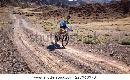 "ALMATY, KAZAKHSTAN - SEPTEMBER 09, 2014: N.Tlegenov (N6) in action at Adventure mountain bike cross-country marathon ""Marathon Bartogay-Assy-Batan""  - stock photo"