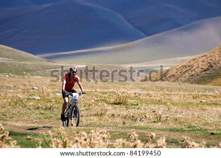 "ALMATY, KAZAKHSTAN - SEPTEMBER 04: V.Ganja (N22) in action at Adventure mountain bike cross-country marathon in mountains ""Marathon Bartogay-Assy-Batan 2011"" September 04, 2011 in Almaty, Kazakhstan. - stock photo"