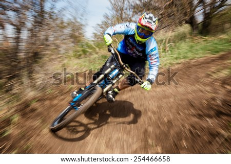 ALMATY, KAZAKSTAN - APRIL 27, 2014: Unknown rider in action at Mountain Bike sports event Downhill Koktybe.  - stock photo