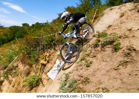 "ALMATY, KAZAKSTAN - AUGUST 03: M.Nesterov (N8) in action at Mountain Bike sports event Superiority of ""Cycling club named A.Vinokurov"" Downhill in Almaty, Kazakstan Aug 03, 2013. - stock photo"
