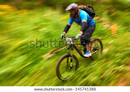 ALMATY, KAZAKSTAN - JUNE 30: D.Alshapov (N19) in action at  Mountain Bike sports event dedicated to the Day of the capital in Almaty, Kazakstan JUNE 30, 2013.