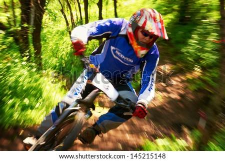 ALMATY, KAZAKSTAN - JUNE 30: D.Gusenkov (N3) in action at  Mountain Bike sports event dedicated to the Day of the capital in Almaty, Kazakstan JUNE 30, 2013. - stock photo
