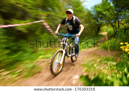 ALMATY, KAZAKSTAN - JUNE 30: G.Karmozin in action at Mountain Bike sports event dedicated to the Day of the capital in Almaty, Kazakstan JUNE 30, 2013.  - stock photo