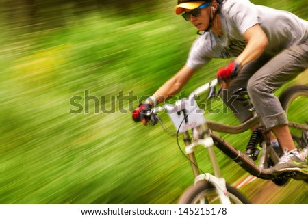 ALMATY, KAZAKSTAN - JUNE 30: I.Levandowsky (N7) in action at  Mountain Bike sports event dedicated to the Day of the capital in Almaty, Kazakstan JUNE 30, 2013. - stock photo