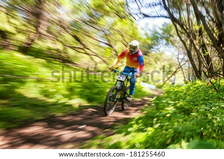 ALMATY, KAZAKSTAN - JUNE 30: O.Narbaev (N21) in action at Mountain Bike sports event dedicated to the Day of the capital in Almaty, Kazakstan JUNE 30, 2013.  - stock photo