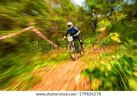 ALMATY, KAZAKSTAN - JUNE 30: Unknown rider in action at Mountain Bike sports event dedicated to the Day of the capital in Almaty, Kazakstan JUNE 30, 2013.  - stock photo