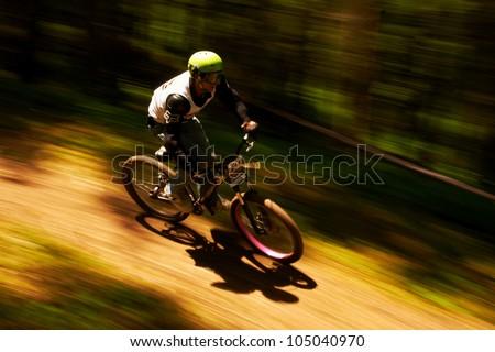 ALMATY, KAZAKSTAN - MAY 27: A.Ledyev (N60) in action at Freestyle Mountain Bike Session in Almaty, Kazakstan MAY 27, 2012. - stock photo