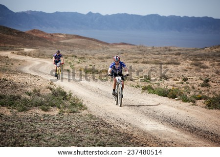 "ALMATY, KAZAKSTAN - MAY 01, 2009: I.Baranov (N6) in action at Adventure mountain bike cross-country marathon in mountains ""Jeyran Trophy 2009""  - stock photo"