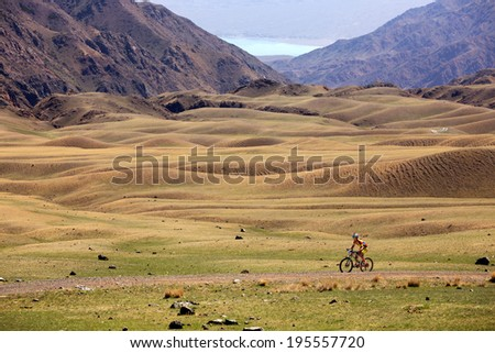 "ALMATY, KAZAKSTAN - MAY 03, 2014: K.Kazantchev (N1) in action at Adventure mountain bike cross-country marathon in mountains ""Jeyran Trophy 2014""  - stock photo"