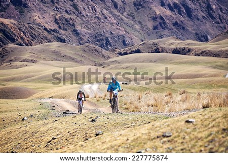 "ALMATY, KAZAKSTAN - MAY 03, 2014: R.Kuznetcov (N9) in action at Adventure mountain bike cross-country marathon in mountains ""Jeyran Trophy 2014"" 		 - stock photo"