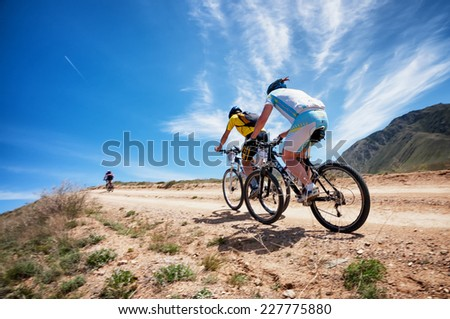 "ALMATY, KAZAKSTAN - MAY 01, 2014: Unidentified bikers in action at Adventure mountain bike cross-country marathon in mountains ""Jeyran Trophy 2014"""