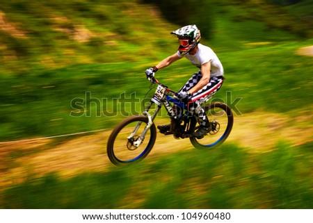 ALMATY, KAZAKSTAN - MAY 26: Unknown rider  in action at Freestyle Mountain Bike Session in Almaty, Kazakstan MAY 26, 2012. - stock photo