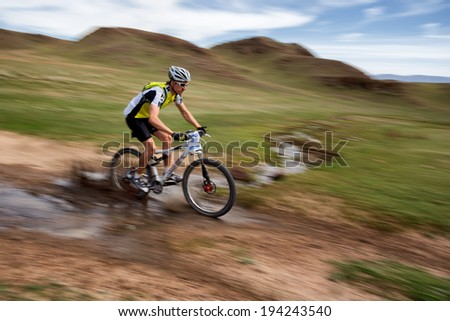 "ALMATY, KAZAKSTAN - MAY 01, 2014: V.Ganja (N40) in action at Adventure mountain bike cross-country marathon in mountains ""Jeyran Trophy 2014""  - stock photo"