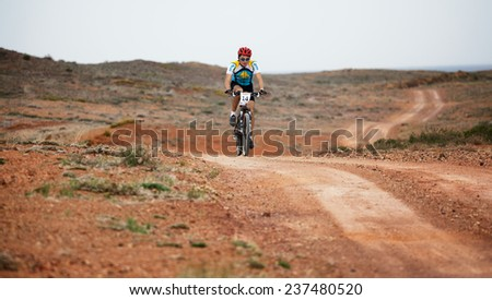 "ALMATY, KAZAKSTAN - MAY 01, 2009: V.Satybaldiev (N14) in action at Adventure mountain bike cross-country marathon in mountains ""Jeyran Trophy 2009""  - stock photo"