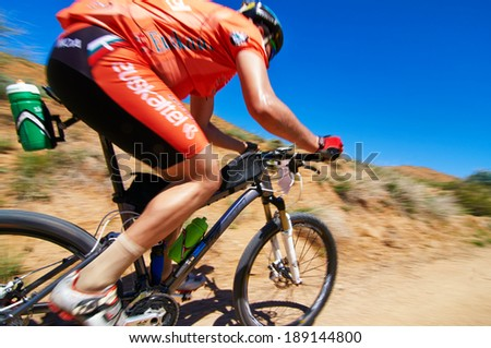 "ALMATY REGION, KAZAKHSTAN - MAY 5, 2013: Unknown rider in action at Adventure mountain bike cross-country marathon in mountains ""Jeyran Trophy 2013"".  - stock photo"