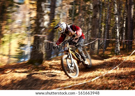 """ALMATY REGION, KAZAKHSTAN - OCTOBER 13: D.Haybullin (N37) in action at  mountain bike sports event """"Red Bull Mountain Rage"""" October 13, 2013 in Almaty region, Kazakhstan. - stock photo"""