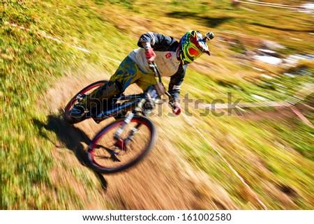 "ALMATY REGION, KAZAKHSTAN - OCTOBER 13: S.Kaganov (N61) in action at  mountain bike sports event ""Red Bull Mountain Rage"" October 13, 2013 in Almaty region, Kazakhstan. - stock photo"
