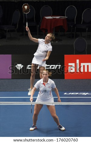 ALMERE - FEBRUARY 2: Eefje Muskens (front) and Selena Piek (back) win the gold medal in the National Championships badminton 2014 in Almere, The Netherlands on February 2, 2014. - stock photo