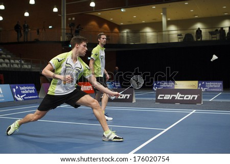 ALMERE - FEBRUARY 2: Koen Ridder (left) and Ruud Bosch (right) reach the final in the National Championships badminton 2014 in Almere, The Netherlands on February 2, 2014. - stock photo
