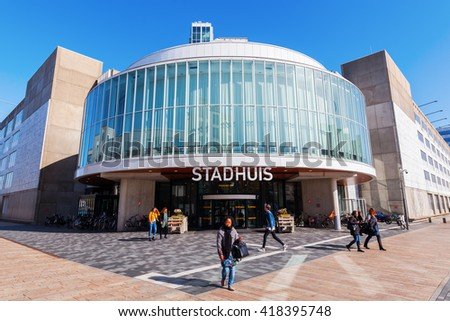 Almere, Netherlands - April 19, 2016: city hall of Almere with unidentified people. Almere is a fast growing, planned city. With a population of about 200,000 it is the 7th largest Dutch city - stock photo