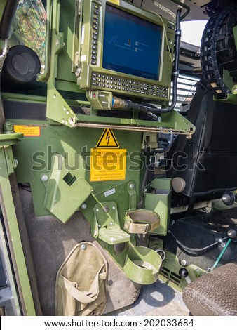 ALMERE, NETHERLANDS - 12 APRIL 2014: Computer inside a Dutch military vehicle on display during the first National Security Day held in the city of Almere - stock photo