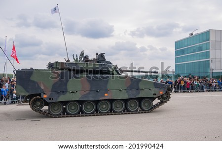 ALMERE, NETHERLANDS - 12 APRIL 2014: Demonstration by a Dutch military armored fighting vehicle during the first National Security Day held in the city of Almere - stock photo