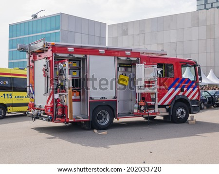 ALMERE, NETHERLANDS - 12 APRIL 2014: Fire engine at scene of an eneacted emergency during the first National Security Day held in the city of Almere - stock photo