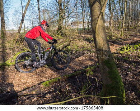ALMERE, NETHERLANDS - FEB. 3, 2014: Mountain biker test riding a brand new  state of the art electric powered mountainbike which uses a motor and provides a smooth and easy ride on rough terrain