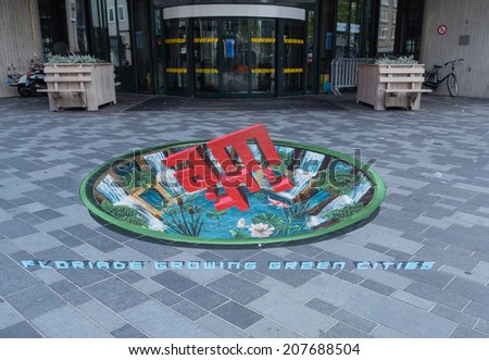 ALMERE, NETHERLANDS - 22 JUNE 2014: Street art showing the power of 3D optical illusion in the streets of the city of Almere - stock photo