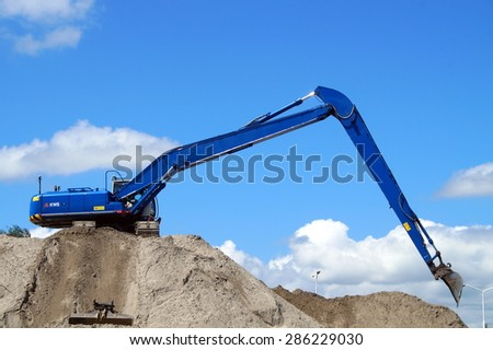 Almere Stad, Flevoland, The Netherlands - June 8, 2015: Hitachi Crawler Excavator working at a sandy Dutch construction site in the fastest growing city of the Netherlands: Almere - stock photo