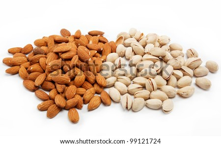 Almond and pistachio nuts on the white. - stock photo