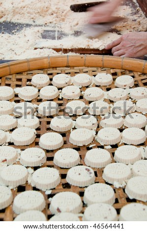 Almond biscuit and biscuit making process in background