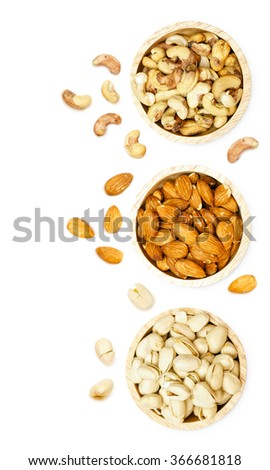 Almond cashew Pistachio snack in wooden bowl isolated on white background