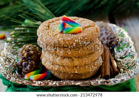 Almond cookies and Christmas decorations and colored caramel