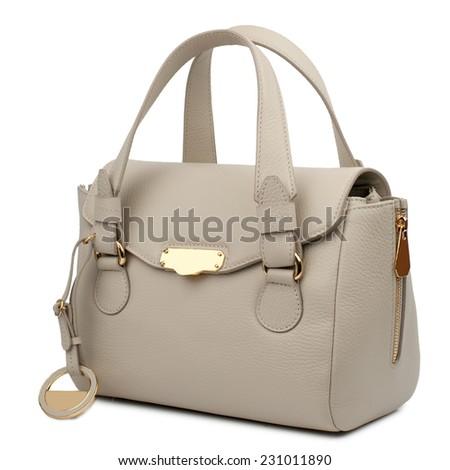 Almond female handbag isolated on white background. - stock photo